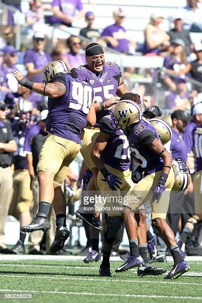 SEP 12 2015 University of Washington's Taniela Tupou celebrated with teammates after he blocked a Sacramento State field goal attempt in the fourth...
