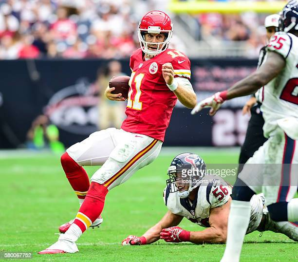 Kansas City Chiefs quarterback Alex Smith evades Houston Texans linebacker Brian Cushing during the Chiefs at Texans game at NRG Stadium Houston Texas