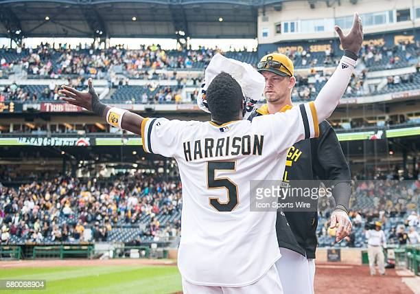 Pittsburgh Pirates third baseman Josh Harrison is hit with a whipped cream pie by Pittsburgh Pirates starting pitcher AJ Burnett after his walkoff...