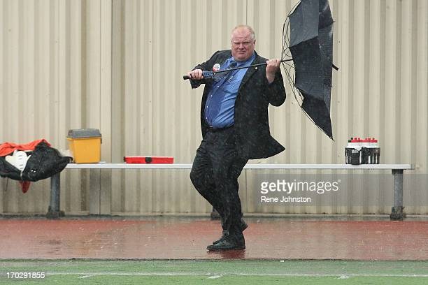 September 14 2010 Rob Ford loses his umbrella in the storm Rob Ford coached his Don Bosco football team to a win in the rain on Thursday