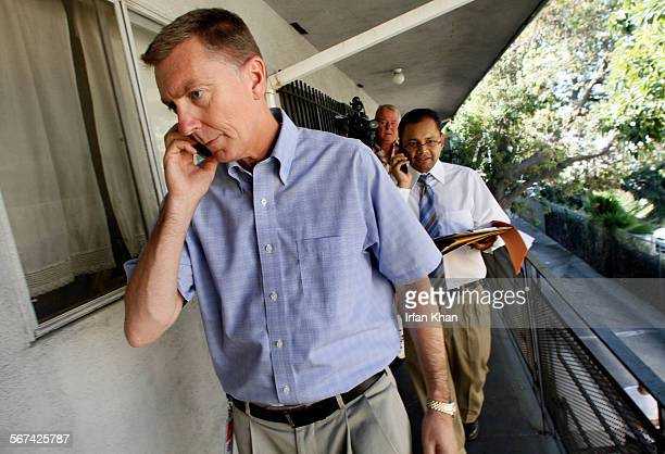 HOLLYWOOD CA September 14 2012 ––– LAUSD Superintendent Dr John Deasy walks through an apartment complex after knocking on the door of a student who...
