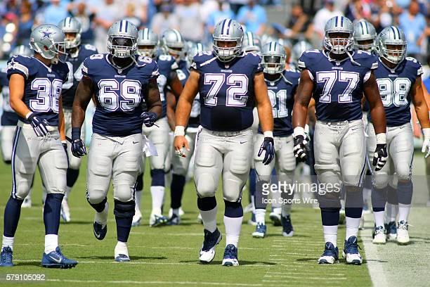 Dallas Cowboys Safety Jeff Heath [14519] Dallas Cowboys Defensive Tackle Henry Melton [11906]Dallas Cowboys Center Travis Frederick [18511] and...