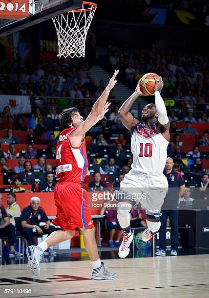 Kyrie Irving of Team USA goes to the basket past G Milos Teodosic of Serbia during Team USA's game versus Serbia in the 2014 FIBA Basketball World...