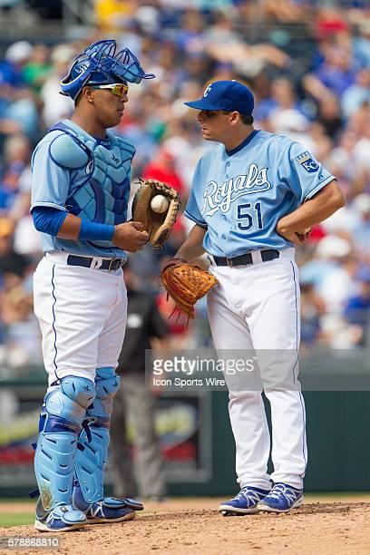 Kansas City Royals starting pitcher Jason Vargas talks to Kansas City Royals catcher Salvador Perez during the MLB game between the Boston Red Sox...