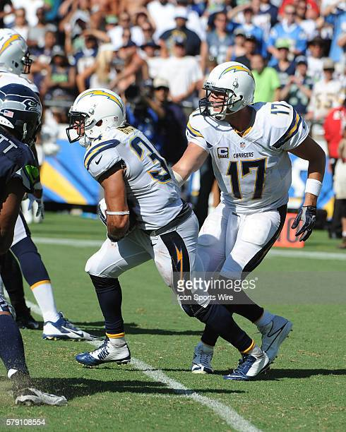 September 14 2014 San Diego California USA San Diego Chargers quarterback Phillip Rivers hands the ball to Chargers running back Donald Brown during...