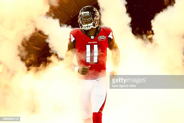 Atlanta Falcons wide receiver Julio Jones emerges from the smoke during the introductions before the start of the NFL game between the Eagles and the...