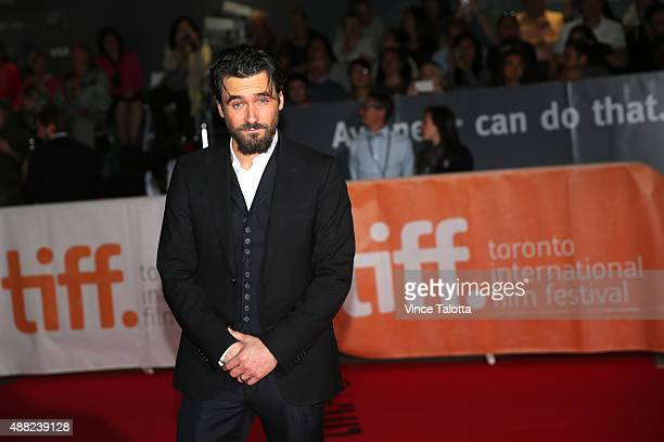 TORONTO ON SEPTEMBER 15 September 15 2015 Actor Allan Hawco poses for pictures on the red carpet at the premiere of Hyena Road at the 40th Toronto...