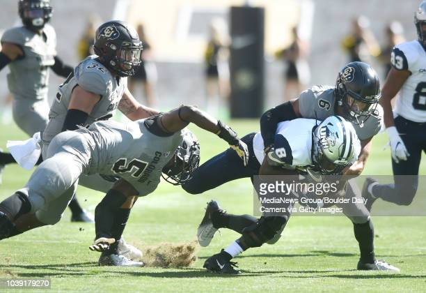 September 15 University of Colorado's Davion Taylor left and Evan Worthington tackle New Hampshire's Trevon Bryant during the game with New Hampshire...