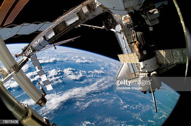 September 17, 2006 - Backdropped by the blackness of space and Earth's horizon, the docked Space Shuttle Atlantis (STS-115) and a Soyuz spacecraft are featured in this image