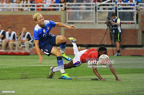 September 17 2015 US Women's National team forward Abby Wambach is taken off of the ball by Haiti defender Roselord Borgella during the game on...