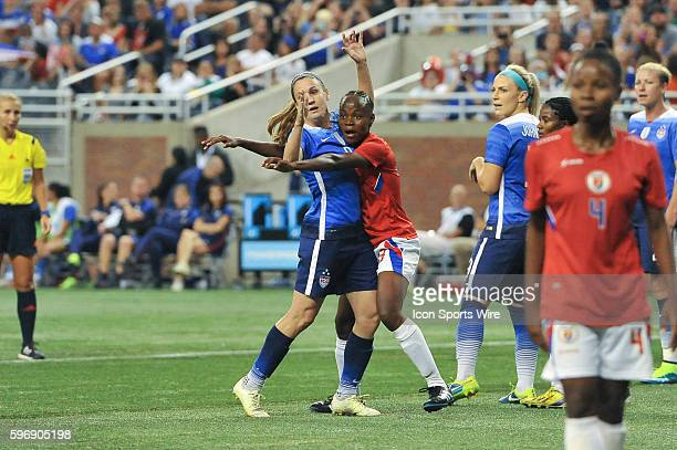 September 17 2015 US Women's National team midfielder Heather O'Reilly and Haiti defender Roselord Borgella battle for position prior to a corner...