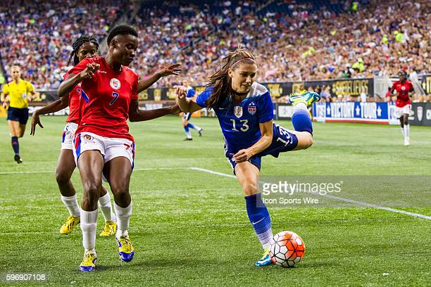 United States forward Alex Morgan attacks the goal against Haiti defender Roselord Borgella during the US Women's 2015 World Cup Victory Tour...