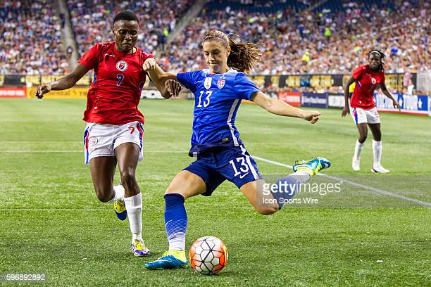 United States forward Alex Morgan takes a shot on goal against Haiti defender Roselord Borgella during the US Women's 2015 World Cup Victory Tour...