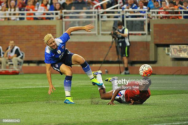 US Women's National team forward Abby Wambach can't get to this pass with Haiti defender Roselord Borgella defending during the game on Thursday...