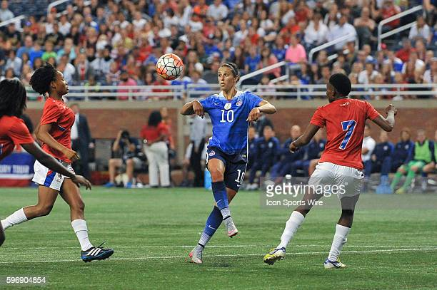 US Women's National team midfielder Carli Lloyd settles this ball in front of Haiti defender Roselord Borgella during the game on Thursday evening...