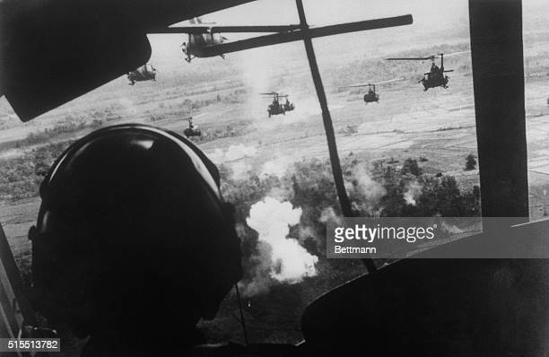 September 18 1965 Bien Hoa South Vietnam Helicopters carrying members of the US 173rd Airborne Brigade fire on a Viet Cong position as they prepare...