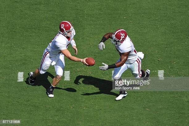 Alabama quarterback Greg McElroy hands off to running back Mark Ingram during a game between the Alabama Crimson Tide and the Duke Blue Devils at...