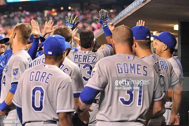 Kansas City Royals catcher Salvador Perez gets congratulations in the dugout following his game tying two run homer in the top of the ninth inning...