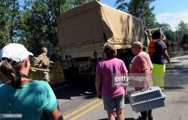 September 18 2018 Conway South Carolina United States Residents wait to board a National Guard vehicle so they can recover possessions and a pet from...
