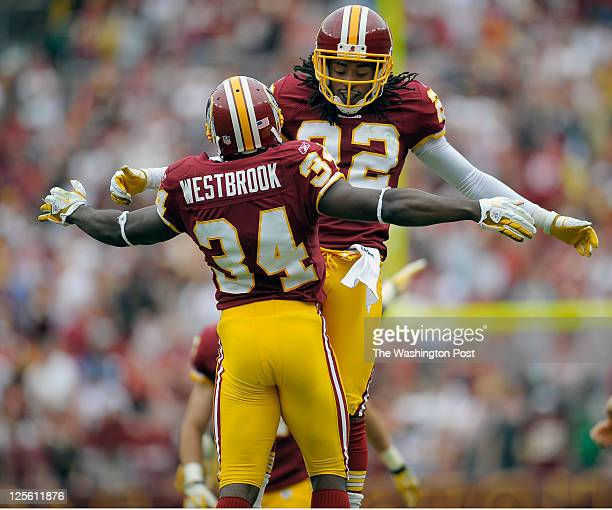 Washington Redskins defensive back Byron Westbrook left chest bumps defensive back Kevin Barnes right after Westbrook force a fumble at the end of...