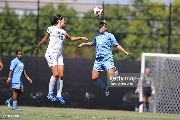 Florida midfielder Holly King and North Carolina midfielder Amber Brooks during a game between the Florida Gators and the North Carolina Tar Heels at...