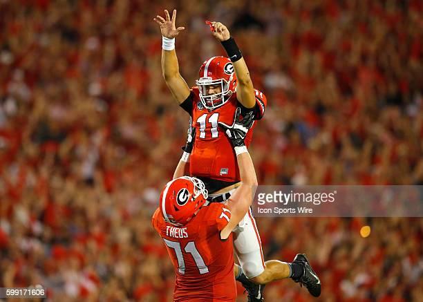 Georgia Bulldogs quarterback Greyson Lambert celebrates a touchdown with offensive tackle John Theus in the Georgia Bulldogs 5220 victory over the...