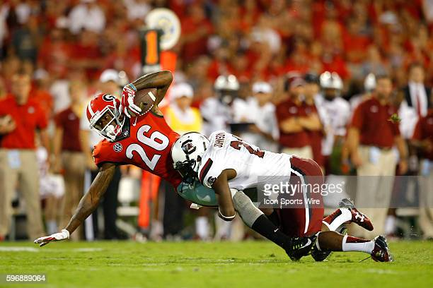 Georgia Bulldogs wide receiver Malcolm Mitchell is tackled by South Carolina Gamecocks safety Isaiah Johnson in the Georgia Bulldogs 5220 victory...
