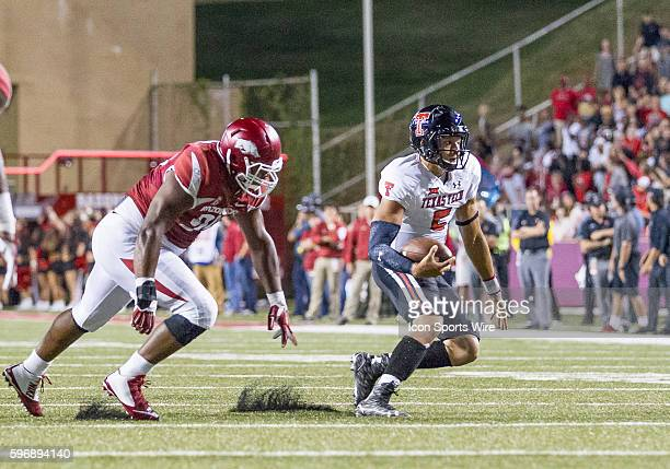 Texas Tech Red Raiders quarterback Patrick Mahomes scrambles for positive yards during the Texas Tech Red Raiders versus University of Arkansas...