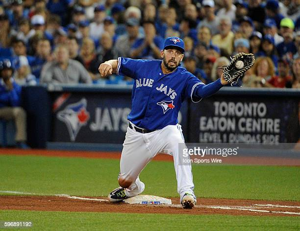 Toronto Blue Jays Designated hitter Chris Colabello [9349] takes a catch from Starting pitcher RA Dickey [1628] from a ground out by Boston Red Sox...