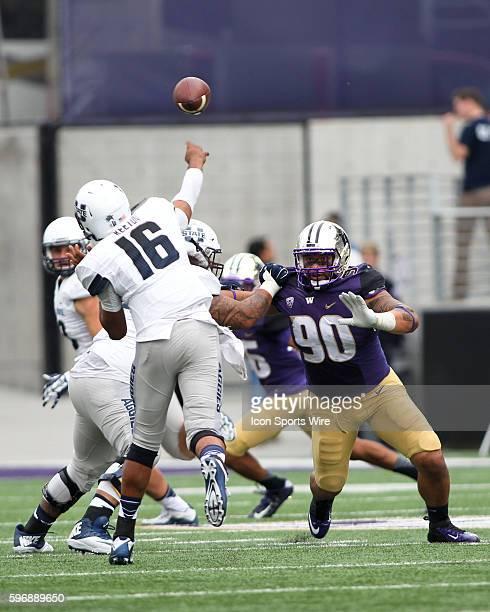 University of Washington's Taniela Tupou brings pressure to Utah State quarterback Anthony Williams Washington defeated Utah State 3117 at Husky...