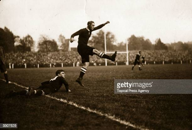 A rugby player kicks a penalty in the match between South Africa and Midland Counties at Leicester