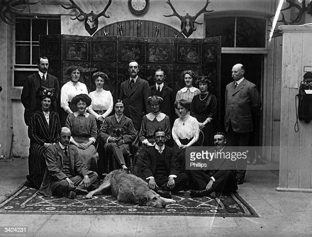 A portrait of visitors gathered at Powerscourt Castle in Enniskerry County Wicklow Left to right standing Lord Farnham Hon Lilah Wingfield Lord...