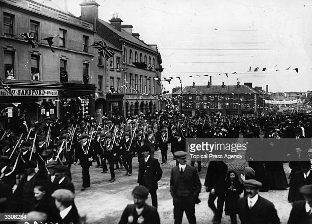 Armed Unionists marching through Portadown County Armagh in a demonstration against Home Rule