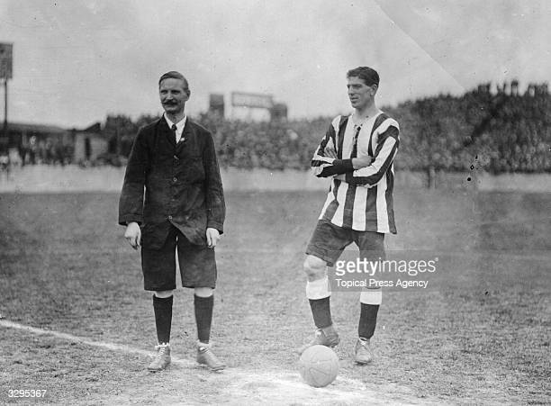 """William """"Bill"""" McCracken, captain of Newcastle United FC, , with referee C R Hall at Plumstead, south London; the opponents are Woolwich Arsenal FC."""