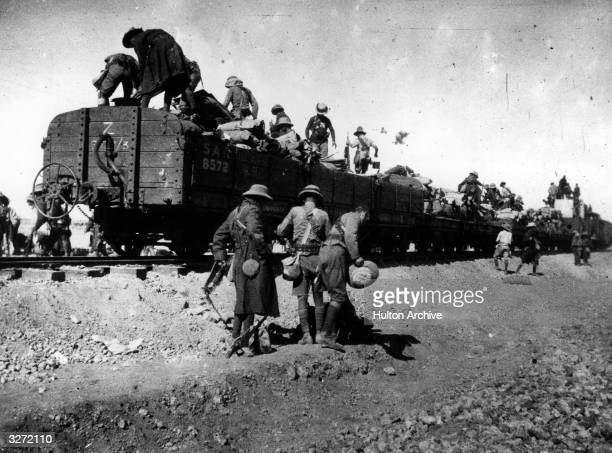 Rhodesian soldiers getting off a train in the desert in the war in South West Africa