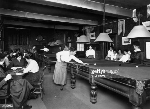 Women playing billiards and draughts in a Women's club