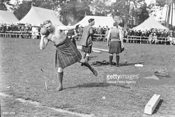 Mr J Graham putting the weight at the Aboyne Highland Games, Aberdeenshire. Highland games are held all over Scotland, and descendants of Scottish...