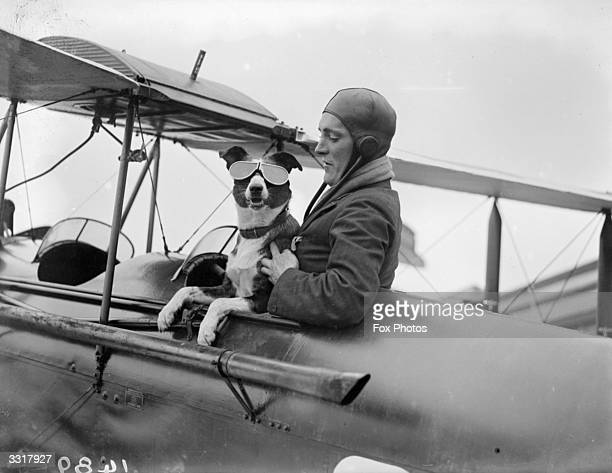 Mr Barnard a member of the London Aero Club makes sure that his canine copilot has the right goggles