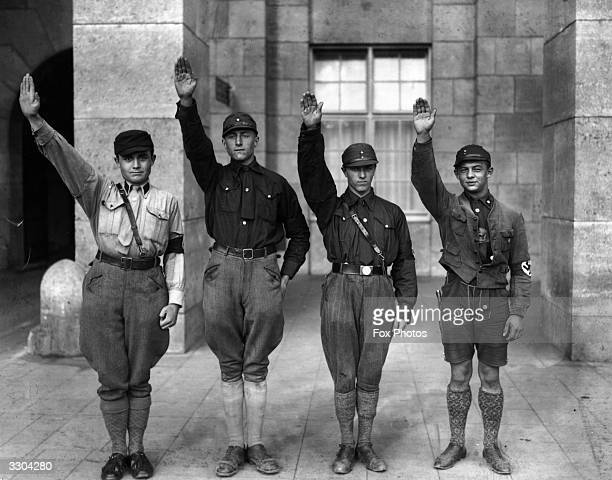 Uniformed members of Hitler's National Socialist party giving the Nazi salute at Munich