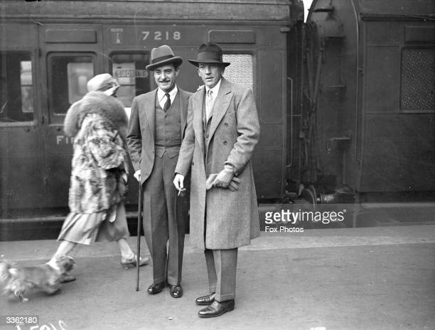 US actor John Gilbert and actor dramatist and composer Noel Coward on a railway platform