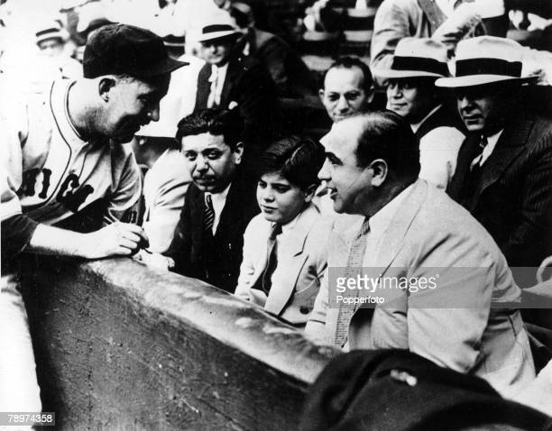September 1931 Chicago USA American prohibitiontime gangster Al Capone is pictured with his son Al at a Chicago Baseball game