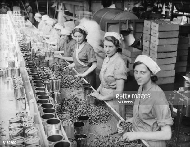 Women on a production line canning beans at Wisbech, Cambridgeshire.