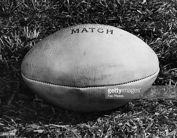 A closeup of an oval rugby football