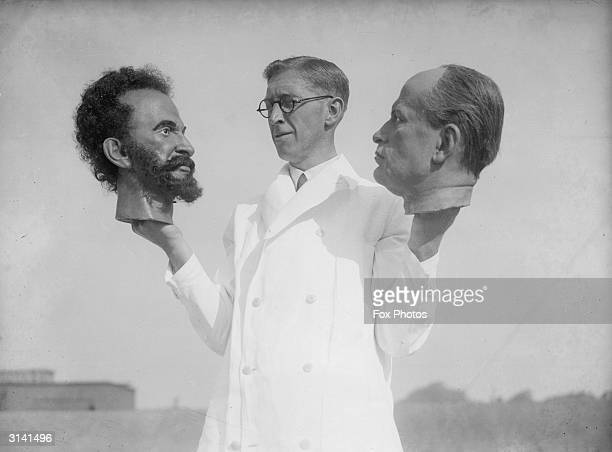Bernard Tussaud grandson of Swiss modeller Madame Tussaud holds two wax heads one of Haile Selassie Emperor of Abyssinia and the other of Italian...