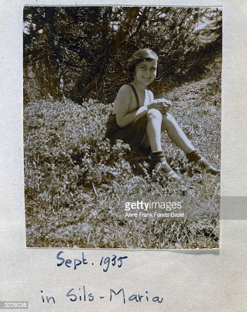 EXCLUSIVE Portrait of Anne Frank sitting in a field near the Villa Laret of Olga Spitzer SillsMaria Switzerland Taken from her photo album