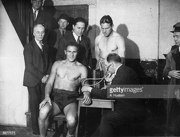 South African boxer Ben Foord looks on as Pancho Villa of Spain has his blood pressure taken at the weighin for their heavyweight fight