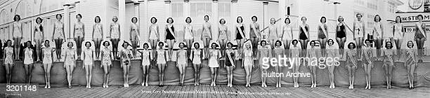 Fulllength portrait of swimsuitclad contestants in the Inter City Beauties Showman's Variety Jubilee pageant posing in two rows at the Steel Pier in...