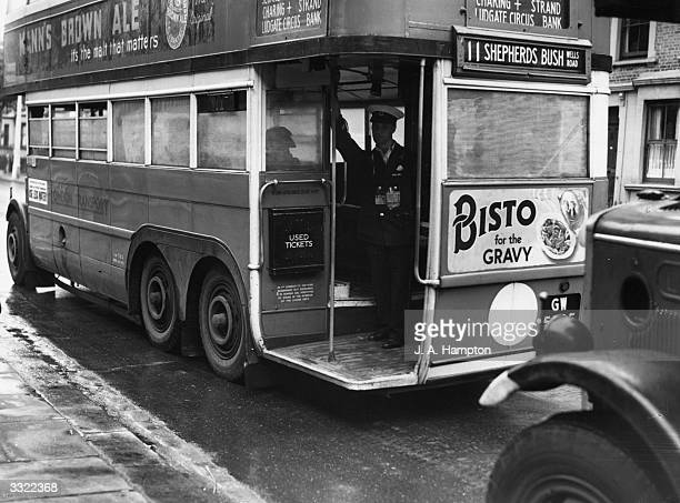 A London bus that has been fitted with adhesive netting over its windows to prevent the glass from shattering during wartime