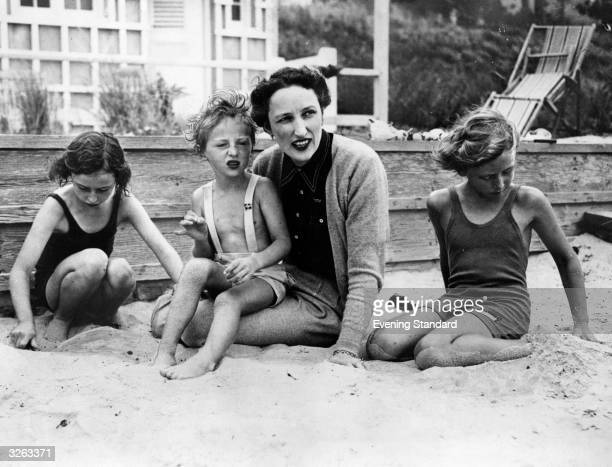 Crown Princess Martha of Norway with her three children Astrid aged 7 Harald aged 3 and Ragnhild aged 9 on the beach at their new home in America