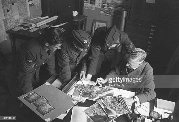 Airmen studying reconnaissance photos during WW II Original Publication Picture Post 872 Photo Reconnaissance unpub